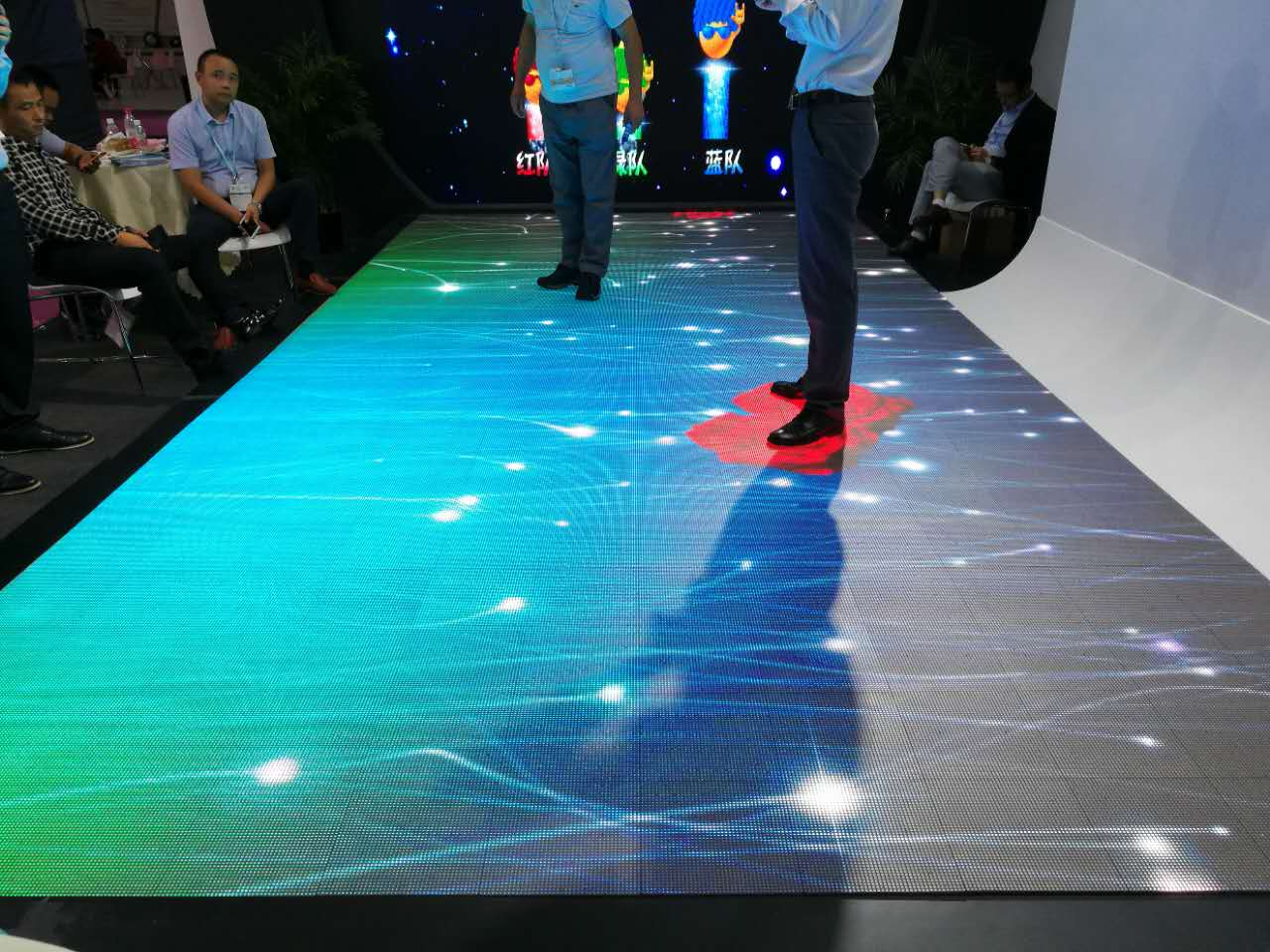 There is an interactive LED floor tile screen re-launch conference.